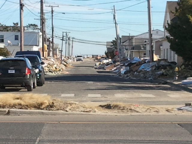 Piles and piles of debris and personal belongings hauled to street for pickup