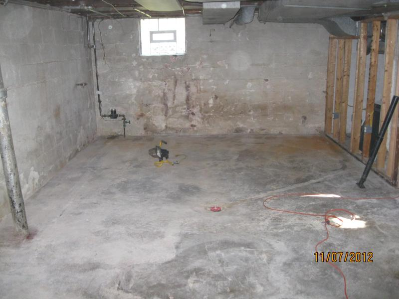 Damaged walls removed and concrete ready for pressure washing and sanitizing